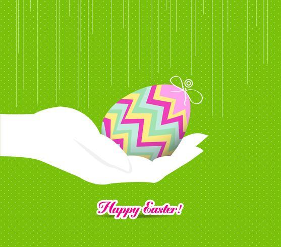 Glad påsk hand som håller ett ägg