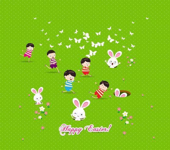 Glückliche Kinder Ostereier spielen das nette Häschen