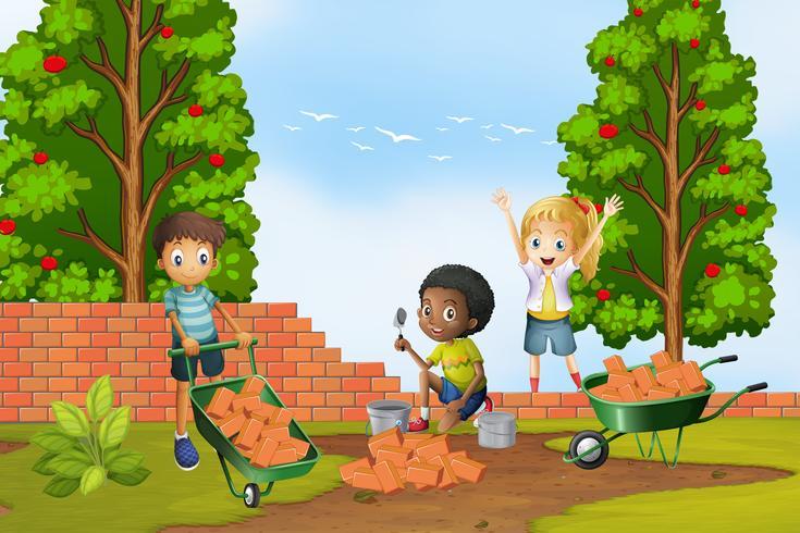Drei Kinder, die Ziegelsteine an der Wand legen