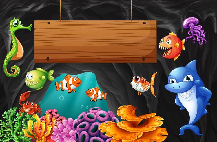 Havsdjur som simmar runt träskylt