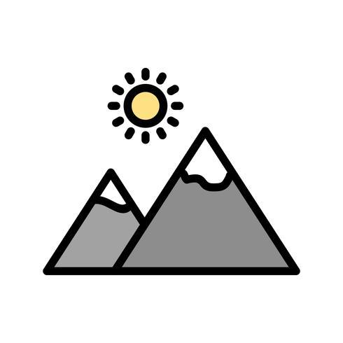 Montagna con icona del sole vettoriale