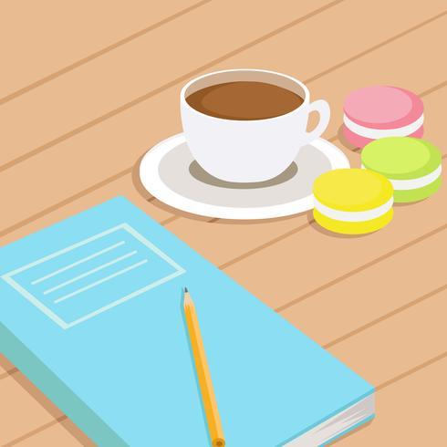 Café y tres macarrones de diferentes colores en la mesa