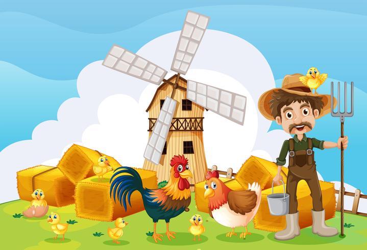 Granjero y molino de viento en la granja