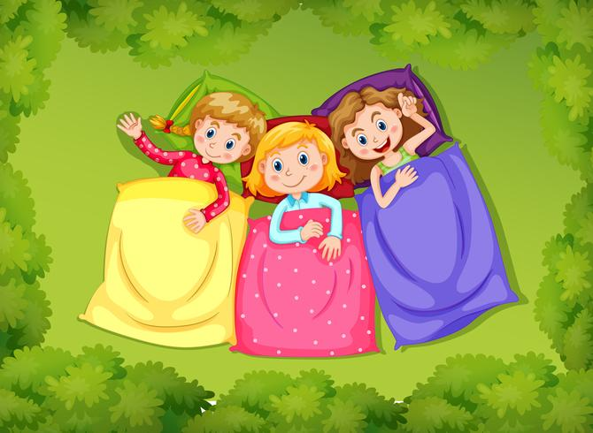 Drei Mädchen, die auf grünem Gras schlafen