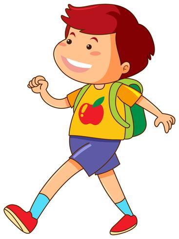 Chico con mochila verde caminando