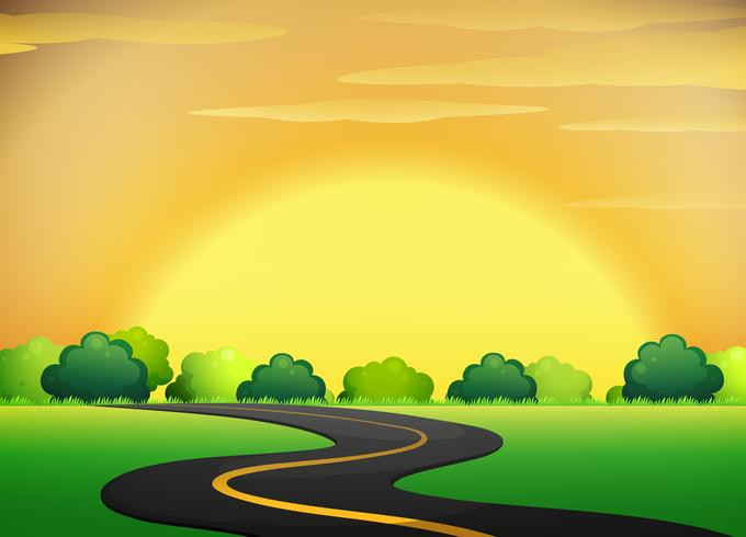 Carretera con paisaje de cielo dorado