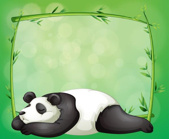 Un escritorio con un marco de bambú y un panda.