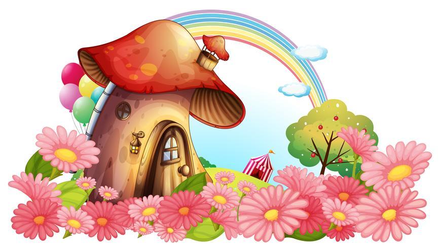 Una casa de setas con un jardín de flores.