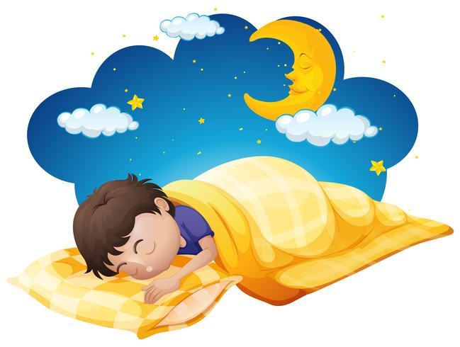 Niño en cama amarilla por la noche