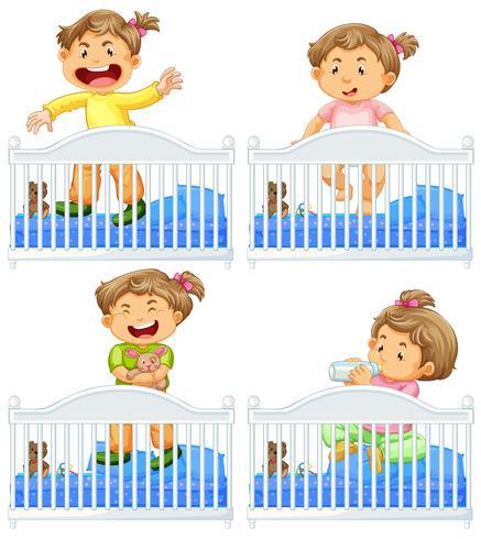 Spädbarn i spjälsäng på vit bakgrund