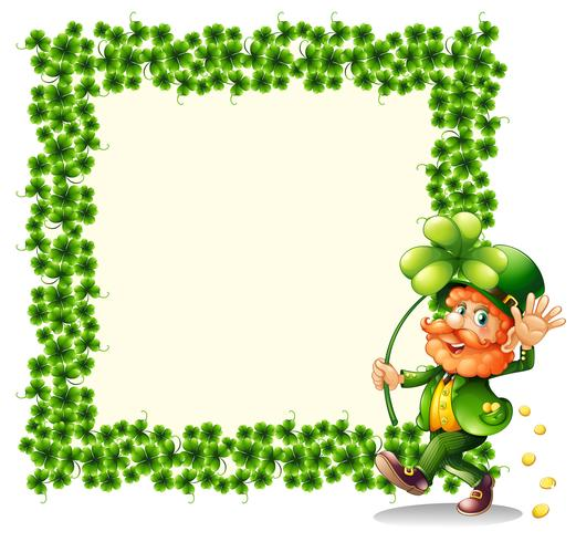 A man holding a clover leaf beside a frame made of leaves