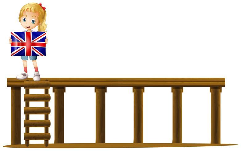Fille et drapeau de l'Angleterre sur scène