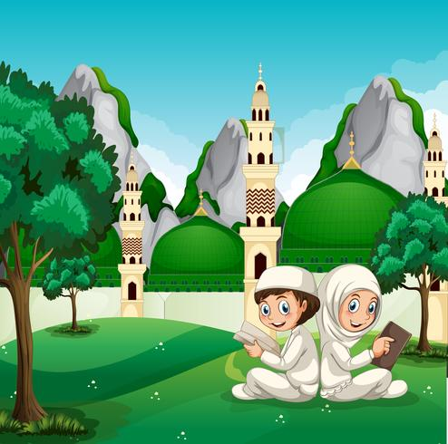 Muslim children reading infront of beautiful mosque