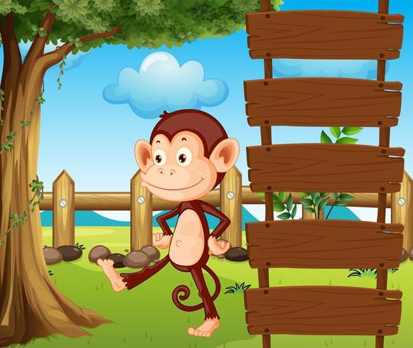Een aap naast een houten bewegwijzering