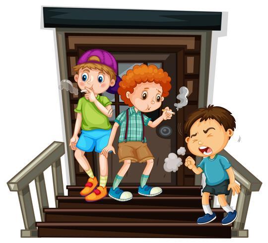 Tre ragazzi che fumano sigaretta sulle scale