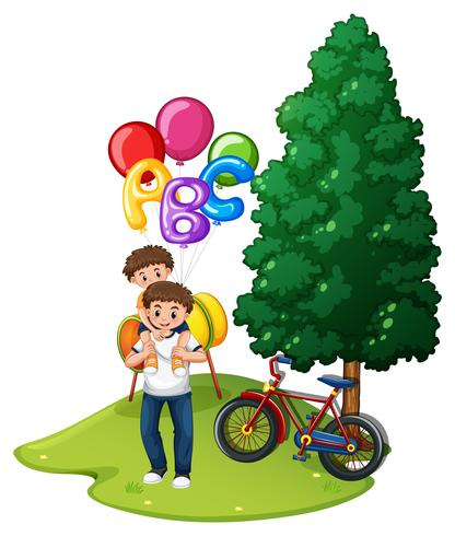 Padre e hijo con globos en el parque