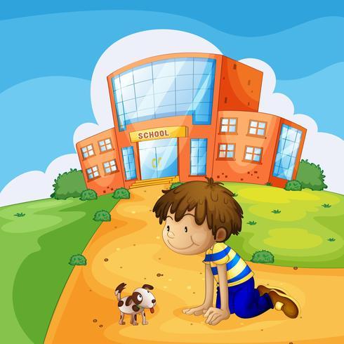 En liten pojke och hans husdjur nära skolan