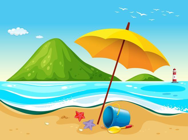Scena della spiaggia con ombrellone e giocattoli