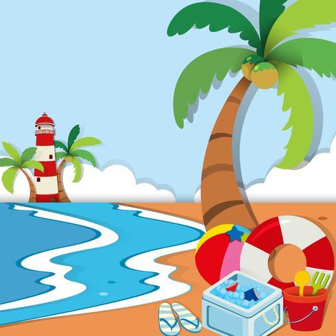 Strandscène met vuurtoren en speelgoed