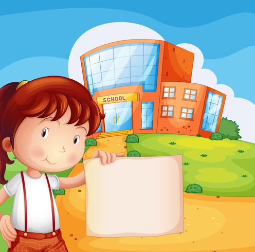 Un bambino di fronte alla scuola con una carta vuota