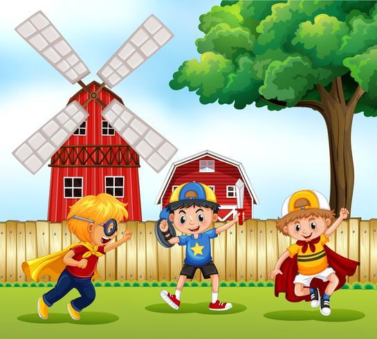 Tres niños jugando héroe en el parque vector
