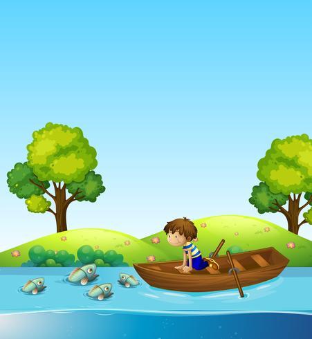 Un niño en el barco viendo peces. vector