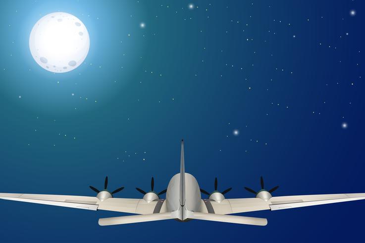 Um avião voando à noite