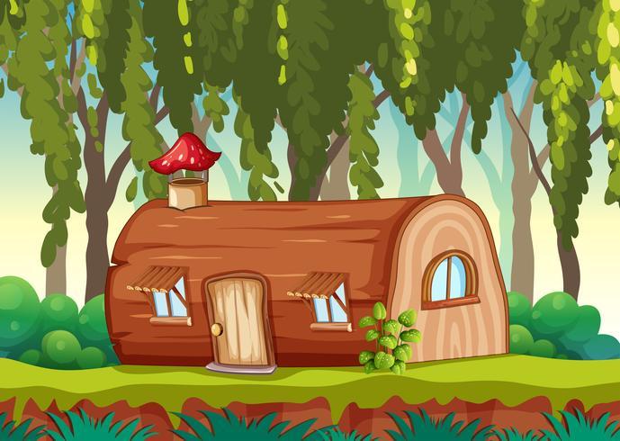 Encantada casa de madera en la naturaleza.