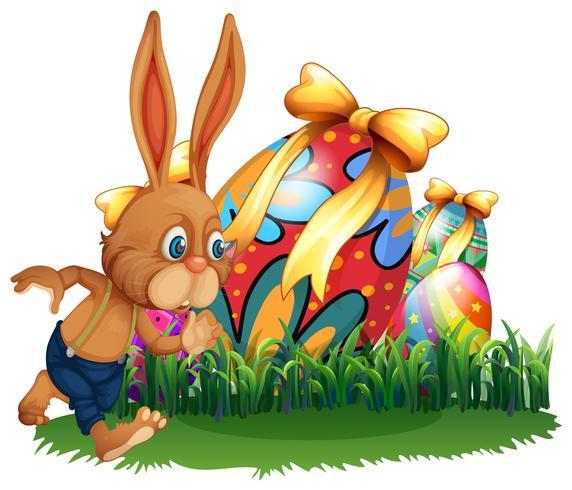 Coelho marrom e ovos de Páscoa