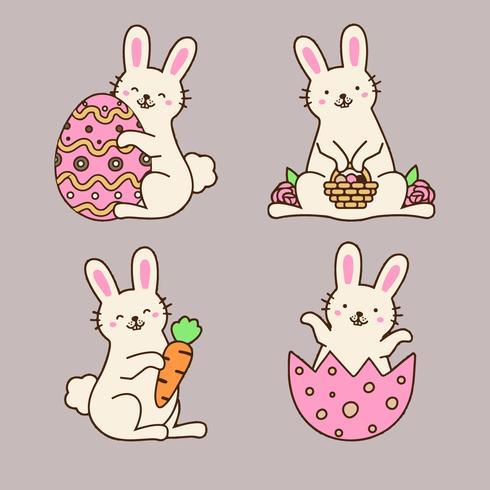 Colección linda del conejito de pascua con los huevos, las flores y la zanahoria.