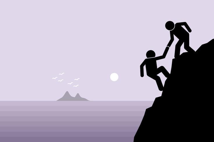 Caminante que ayuda a un amigo que sube a un peligroso acantilado rocoso en la montaña levantándolo con la mano.