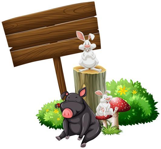Maiale e conigli con cartello in legno