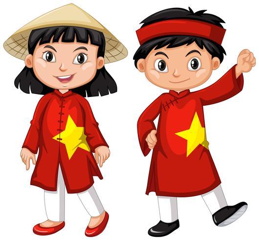 Vietnamese jongen en meisje in rood kostuum