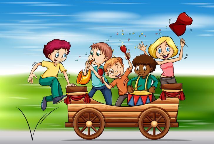 Bambini che suonano strumenti sul carro