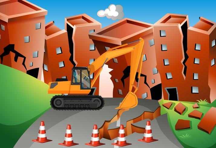 Escena del terremoto con bulldozer y edificios.