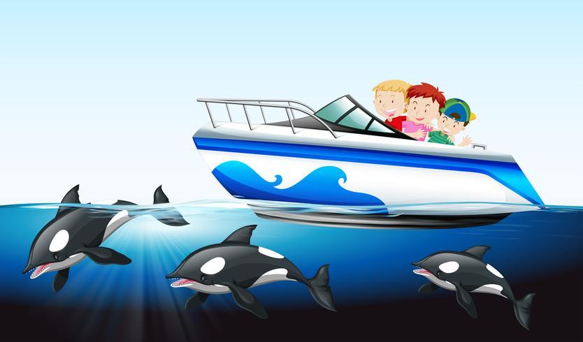 Niños en bote y ballena bajo el agua.