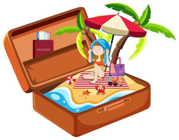 Chica en la playa en equipaje
