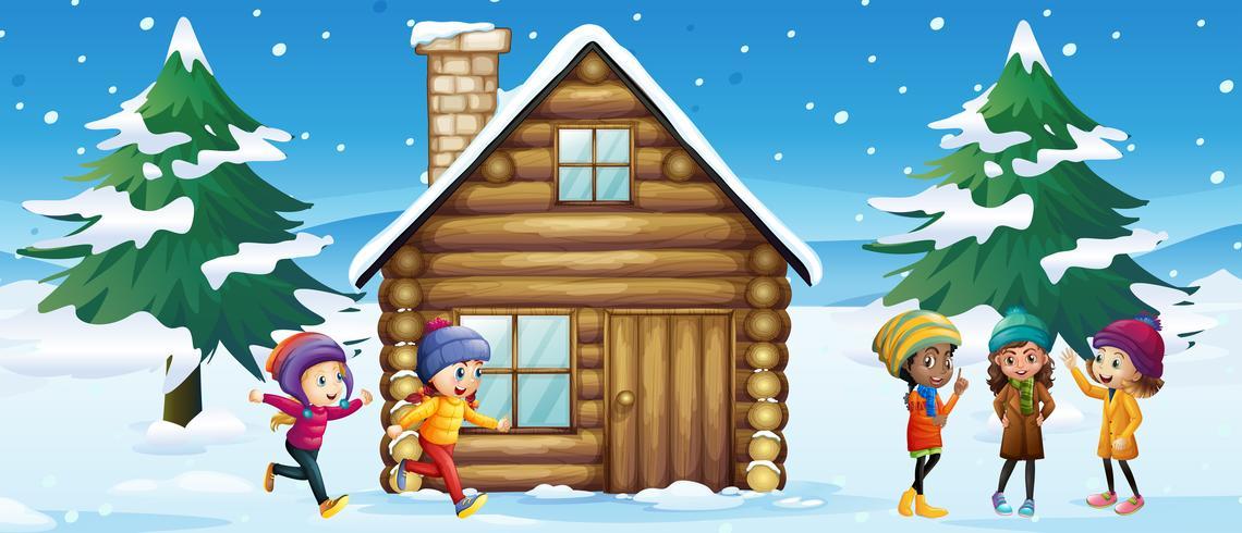De winterscène met kinderen die in de sneeuw spelen vector