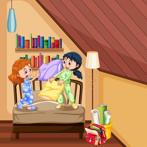 Zwei Mädchen, die Kissen im Schlafzimmer spielen vektor