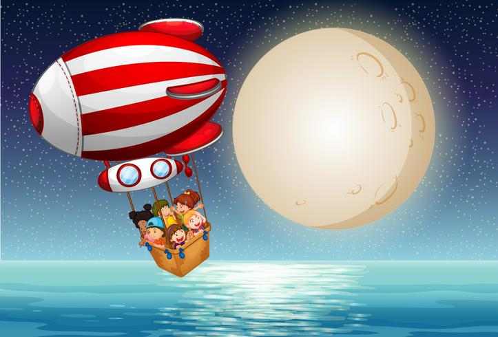 Kinderen rijden 's nachts in de heteluchtballon vector