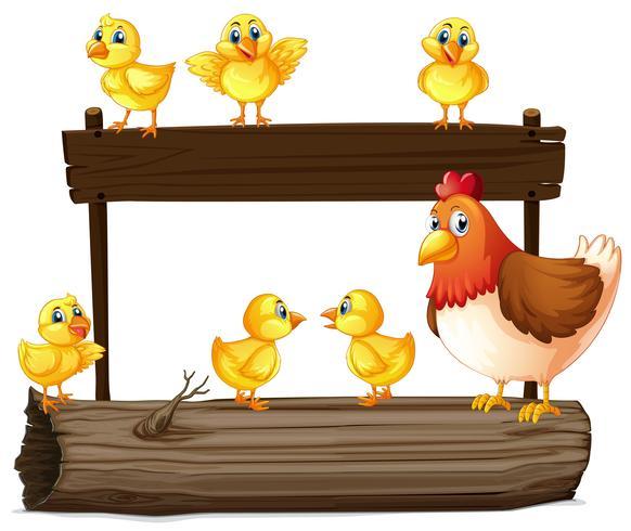 Cartel de madera con gallina y pollitos.