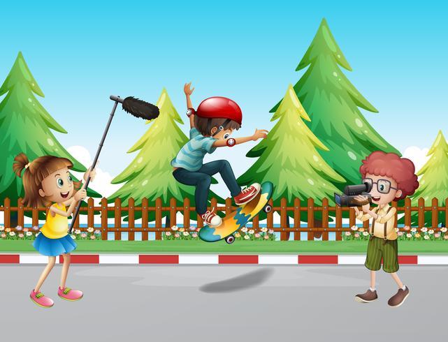 Children shooting vdo with boy skateboarding vector
