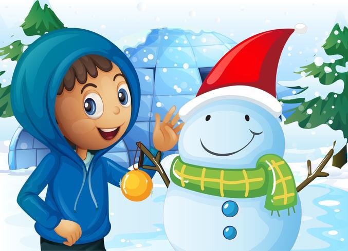 Niño y muñeco de nieve en el campo