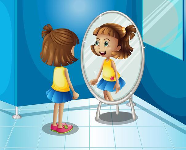 Glückliches Mädchen, das den Spiegel im Badezimmer betrachtet