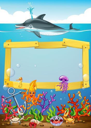 Ramdesign med delfin under vattnet vektor