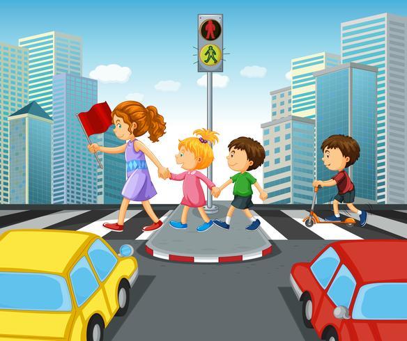 Niños cruzando la calle en la ciudad.