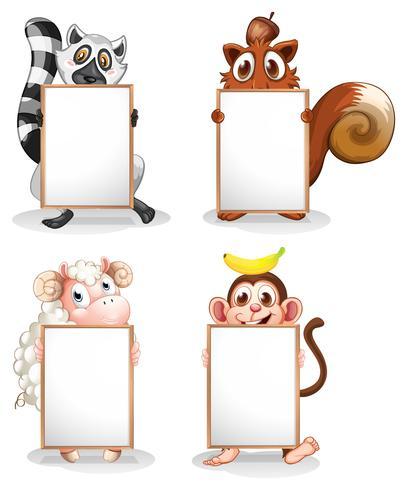 Vier verschillende dieren met lege whiteboards