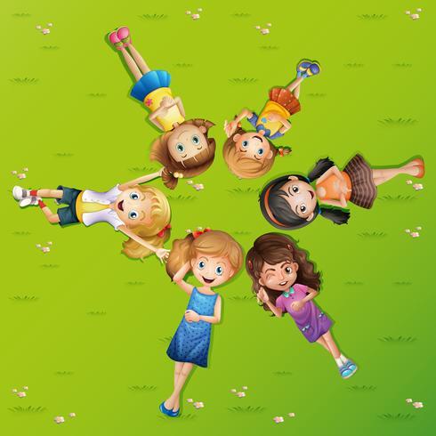 Many happy girls lying on grass vector