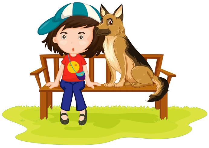 Girl and dog sitting in the park