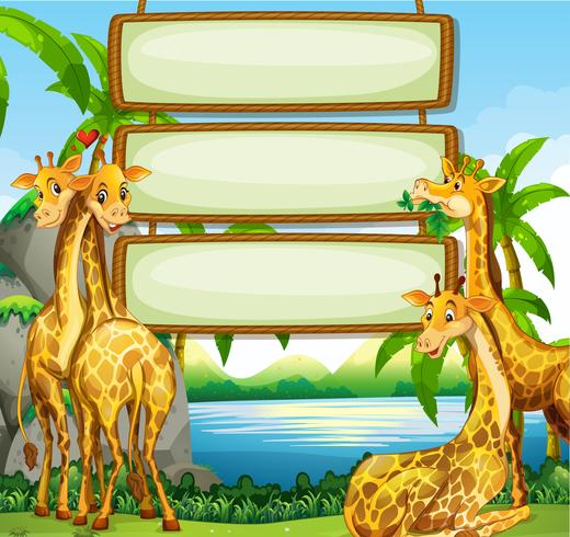 Sign template with giraffe in the fiel